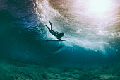 Surfer duck diving under a wave, Hawaii, America, USA