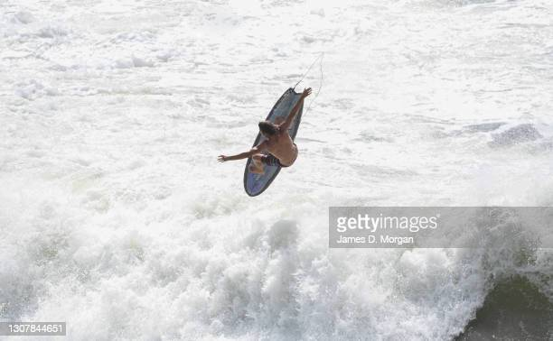 Surfer enjoys the large swell caused by an east coast low on March 19, 2021 in Lennox Head, Australia. Heavy rainfall and large swells have gripped...