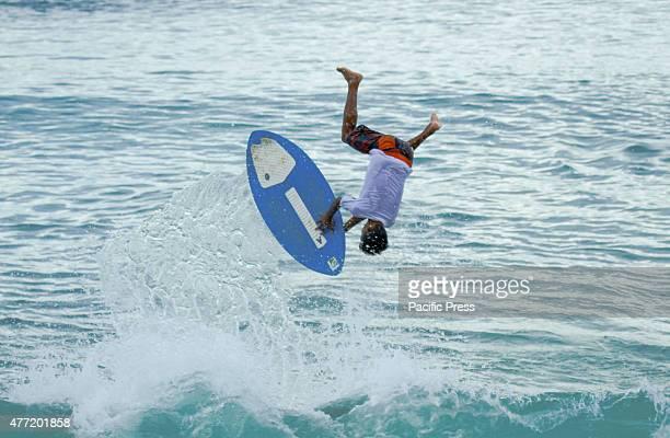 A surfer enthusiast enjoys the waves of Dahican Beach Dahican Beach is a white sand crescentshaped 7kilometer long beach in Mati City Davao Oriental...