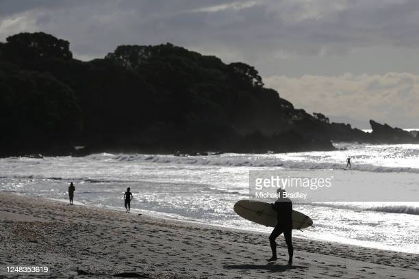 Surfer exists the water after a surf on June 09, 2020 in Cambridge, New Zealand. COVID-19 restrictions lifted at midnight as New Zealand moved to...