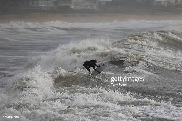 A surfer experiences turbulent seas at Avoca Beach on the Central Coast on April 22 2015 in Sydney Australia Three people have died and more than...