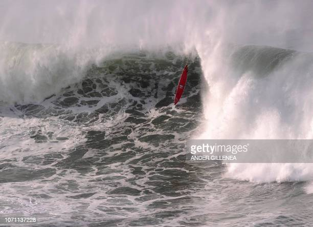 A surfer falls during the Punta Galea Challenge big wave surfing competition in the Northern Spanish city of Getxo on December 10 2018