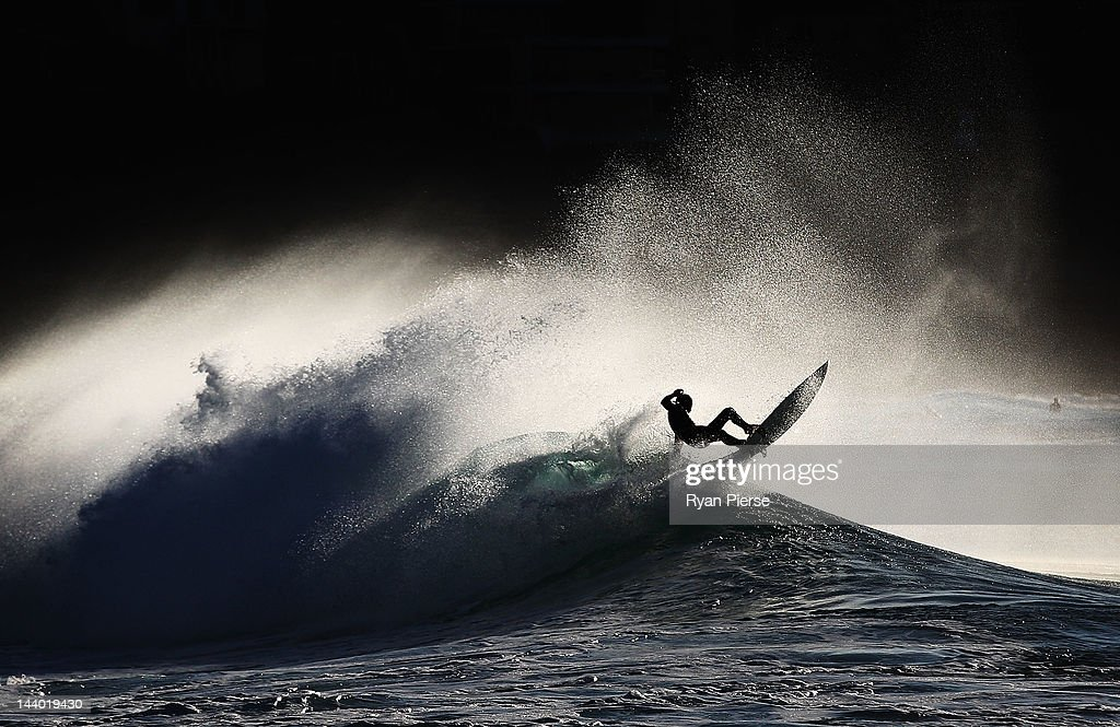 A surfer falls from his board while surfing at Bronte Beach on May 8, 2012 in Sydney, Australia.