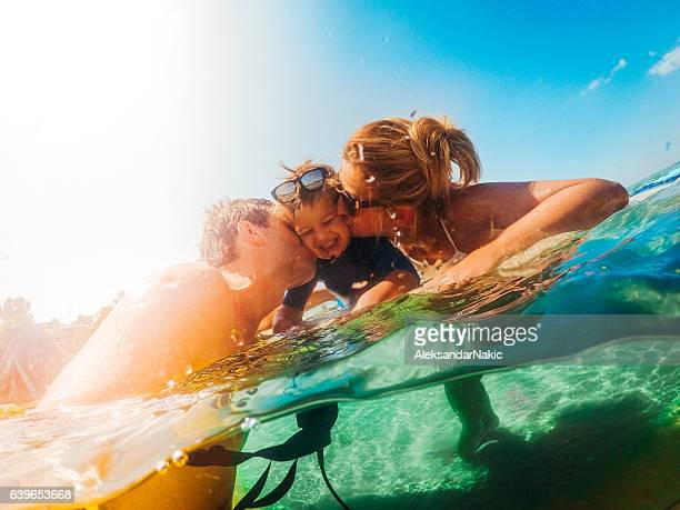 Surfer family in the sea