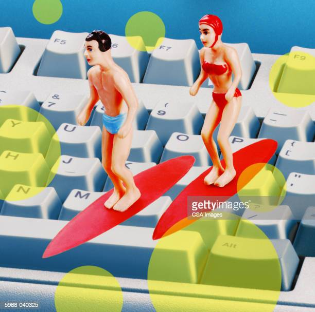 Surfer Figurines on Keyboard