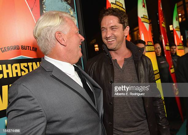 Surfer Frosty Hesson and actor Gerard Butler arrive to the premiere of 20th Century Fox's Chasing Mavericks on October 18 2012 in Los Angeles...