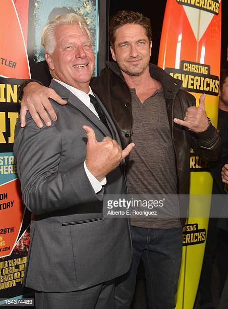 """Surfer Frosty Hesson and actor Gerard Butler arrive to the premiere of 20th Century Fox's """"Chasing Mavericks"""" on October 18, 2012 in Los Angeles,..."""
