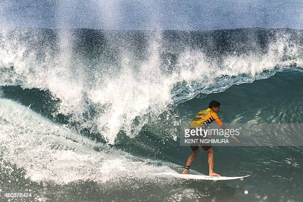 Surfer Gabriel Medina of Brazil rides a wave during Round One of the Pipeline Masters surfing event of the Vans Triple Crown of Surfing at Ehukai...