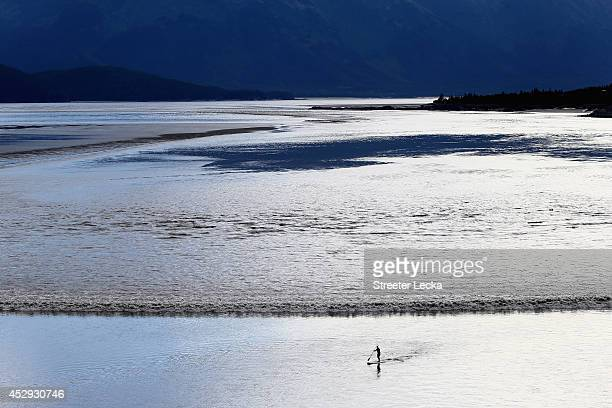 A surfer gets into position to ride the Bore Tide at Turnagain Arm on July 15 2014 in Anchorage Alaska Alaska's most famous Bore Tide occurs in a...