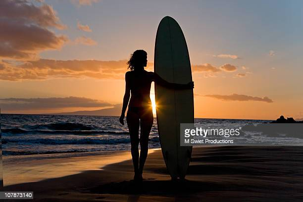 surfer girl at sunset - image title stock pictures, royalty-free photos & images