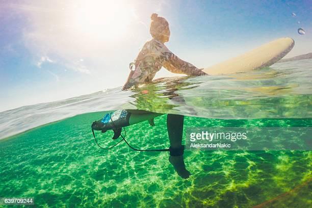 Surfer girl floating on a surfboard