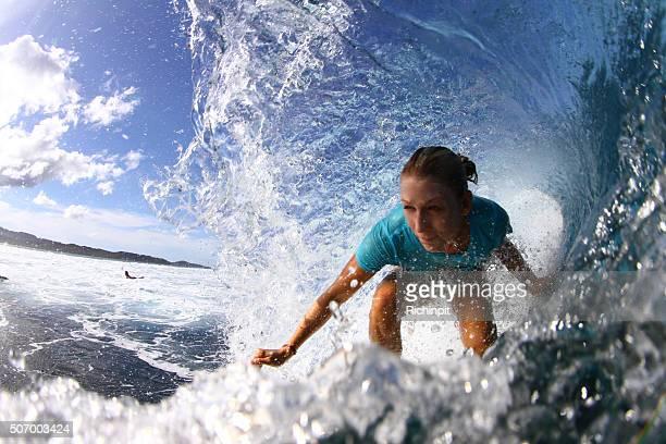 Surfer girl gets barreled