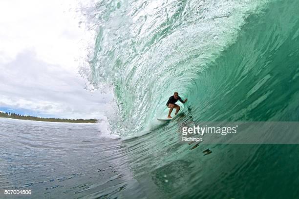 Surfer girl in a big barrel