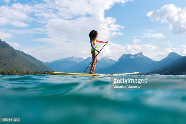 Surfer girl on stand up board