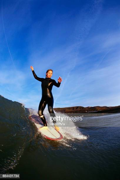 Surfer Girl Riding a Wave