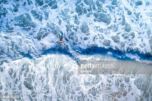 Surfer girl surfing in the ocean