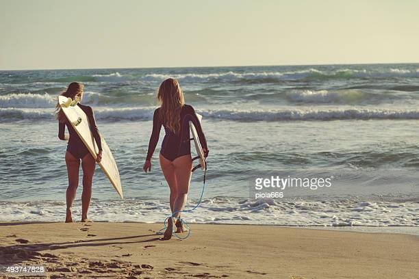 Surfer girls by the sea