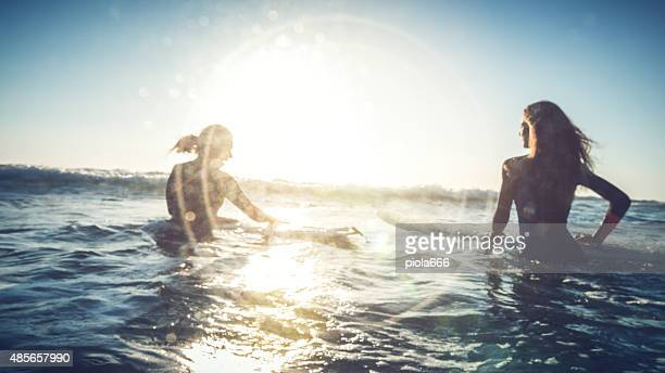 Surfer girls in action