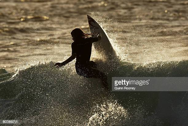 A surfer has an early morning surf at Winkipop Beach before the start of the Rip Curl Pro as part of the ASP World Tour held at Bells Beach March 18...