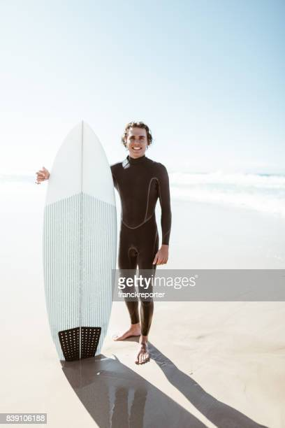 surfer have fun on the beach in australia - wetsuit stock pictures, royalty-free photos & images
