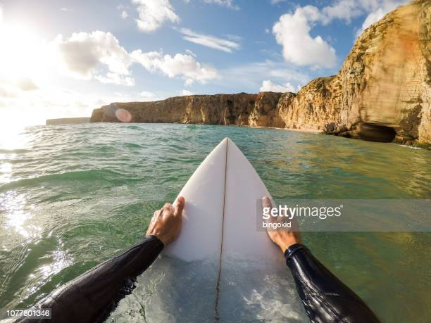 surfer holding a surfboard in water - point of view stock pictures, royalty-free photos & images
