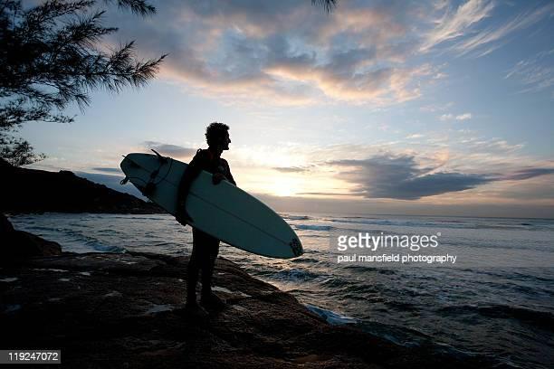 Surfer holding surfboard
