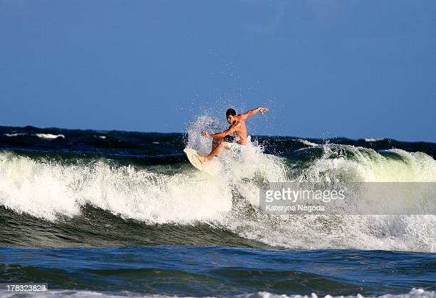Surfer in action. Atlantic ocean, Maceio, Alagoas, Brazil.