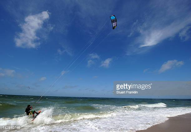 A surfer in action during the Mini World Cup of Kitesurfing at the beach at Westerland on July 1 2012 on Sylt Germany