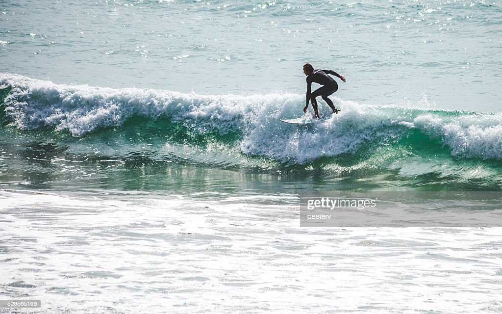 Surfer in action. : Stock Photo