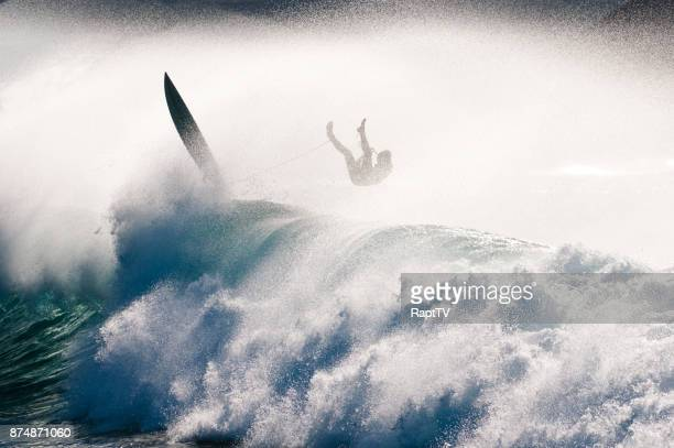 a surfer in mid air on a big wave. - failure stock pictures, royalty-free photos & images