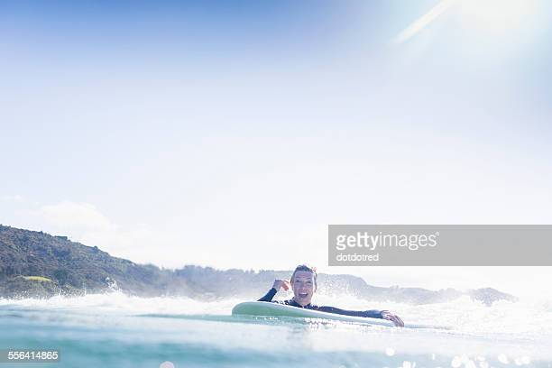 surfer in the water, bay of islands, new zealand - northland new zealand stock pictures, royalty-free photos & images
