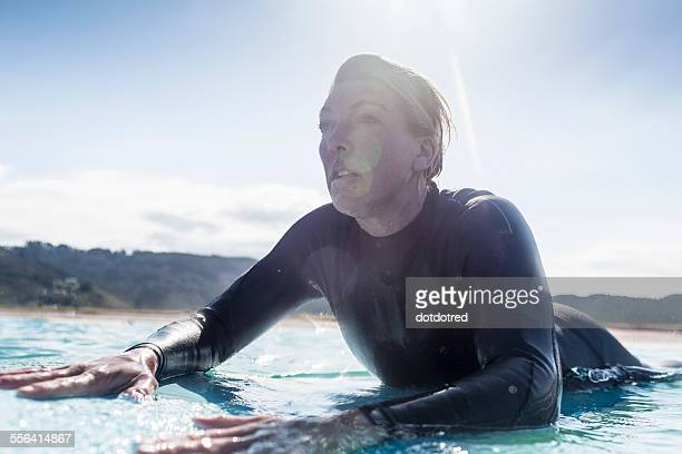 Surfer in the water, Bay of Islands, NZ