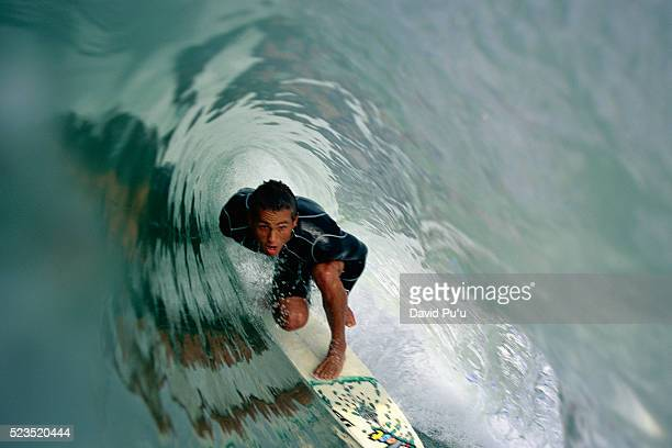 surfer inside a breaking wave - western usa stock pictures, royalty-free photos & images