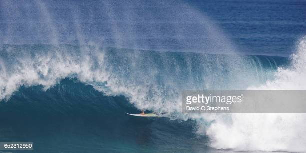 surfer inside the bonzai pipeline - waimea bay stock pictures, royalty-free photos & images