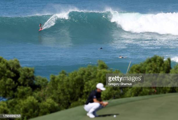 Surfer is seen as Joaquin Niemann of Chile lines up a putt on the 11th green during the final round of the Sentry Tournament Of Champions at the...