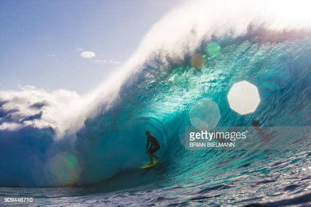 Surfer John John Florence rides the barrel during a late afternoon free surf session at the legendary Banzai Pipeline on the North shore of Oahu...