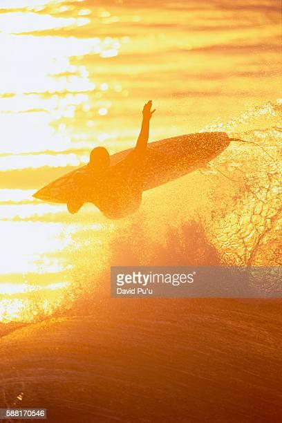 Surfer Jumping Ocean Wave