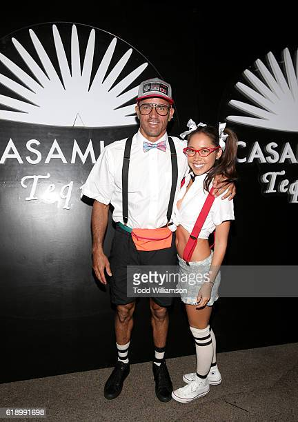 Surfer Kelly Slater and guest arrive to the Casamigos Halloween Party at a private residence on October 28 2016 in Beverly Hills California
