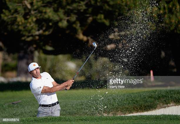 Surfer Kelly Slater hits a bunker shot during the third round of the ATT Pebble Beach National ProAm at the Pebble Beach Golf Links on February 14...
