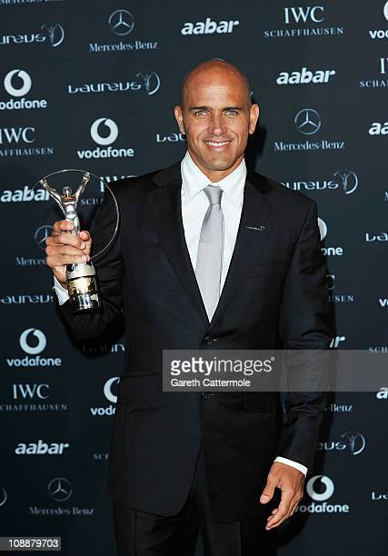 """Surfer Kelly Slater of the United States poses with his award for """"Laureus World Action Sportsperson of the Year"""" in the winners studio at the 2011..."""
