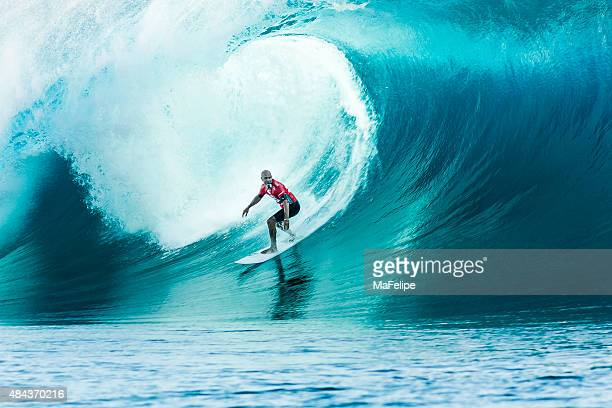 surfer kelly slater surfing 2014 billabong pro tahiti - red tube stock pictures, royalty-free photos & images