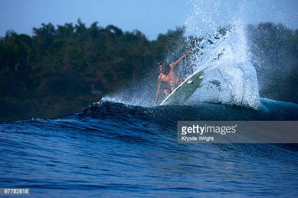 A surfer lands an aerial move at G-Land, Java, Indonesia.