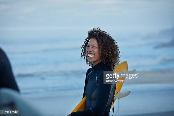 Surfer laughing on the beach