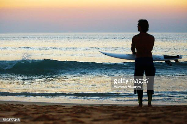 Surfer looking at the sunset