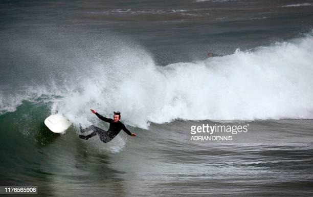A surfer loses his footing as he rides a wave at Towan Beach in Newquay south west England on October 18 2019 Newquay is hosting The annual British...