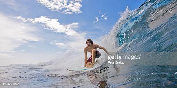 Surfer man rides glassy wave