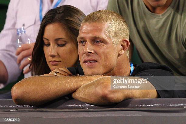 Surfer Mick Fanning and his wife Karissa watch the quarterfinal match between Novak Djokovic of Serbia and Tomas Berdych of the Czech Republic during...