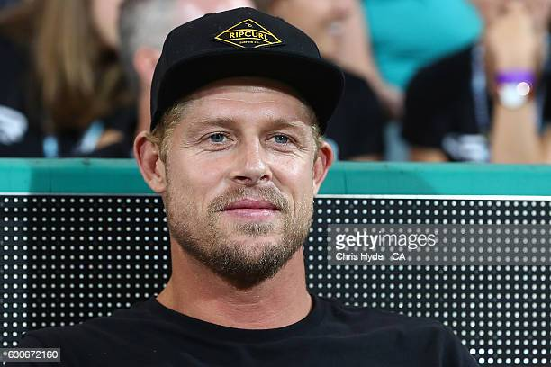 Surfer Mick Fanning watches the Big Bash League between the Brisbane Heat and Hobart Hurricanes at The Gabba on December 30 2016 in Brisbane Australia