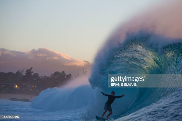 TOPSHOT Surfer Miguel Tudela of Peru comes out of a barrel during a late afternoon free surf session at the legendary Banzai Pipeline on the North...