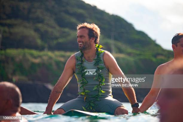 US surfer Nathan Fletcher takes part in the opening ceremony of the 2018 Eddie Aikau Big wave Invitational Surfing Event at Waimea Bay on the north...